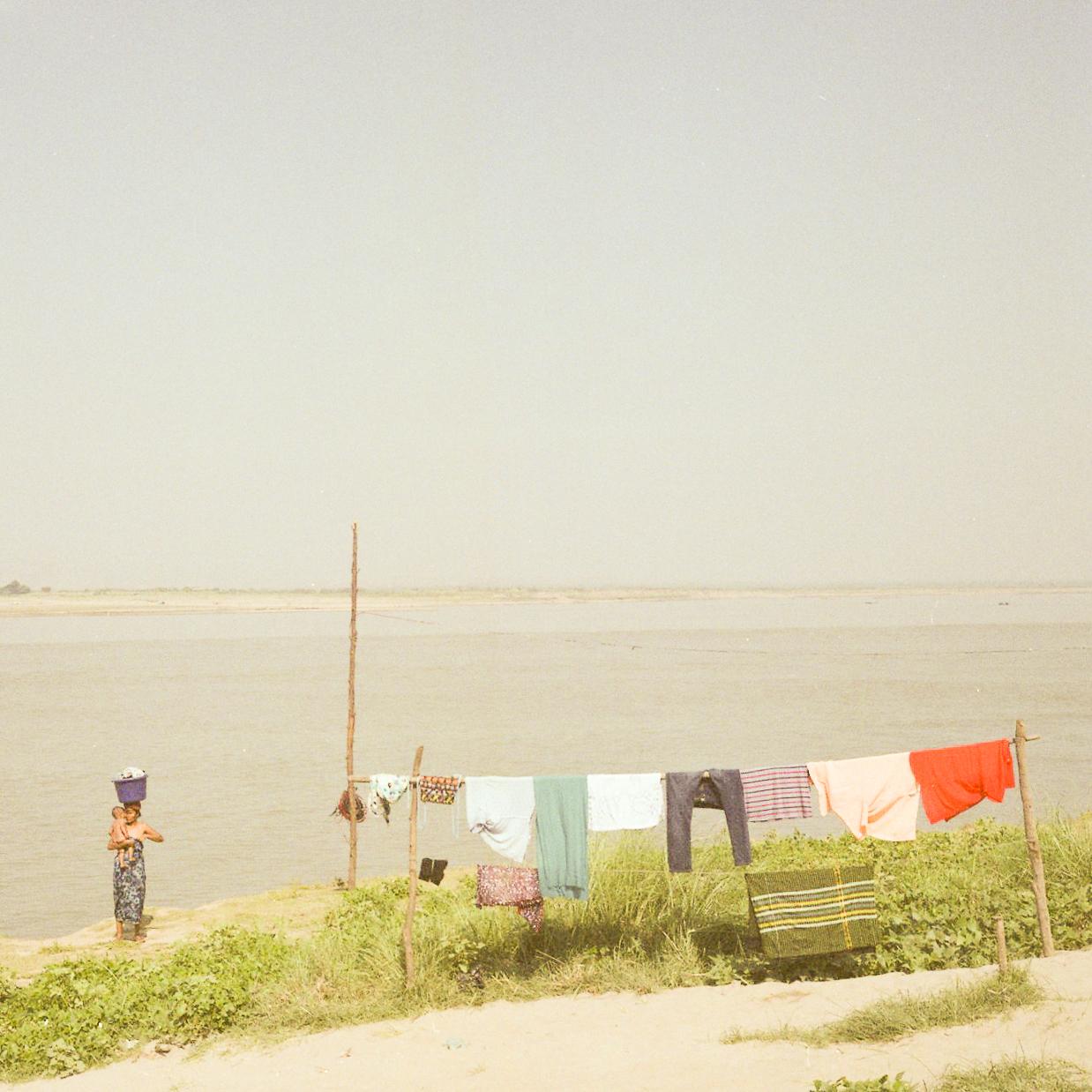 mother make laundry in Bagan, fine art photography , travel photography, shooting film, medium format, Myanmar, Burma,raffaele ferrari, rolleiflex, fujifilm